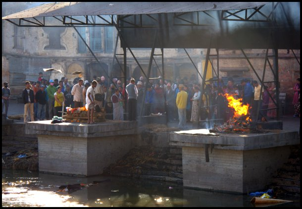 Cremation ceremony being carried out by the Bagmati River